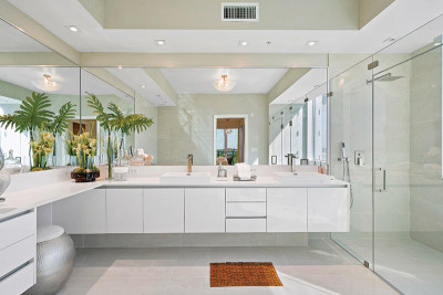 Luxury master bathroom vanity and glass enclosed rain shower