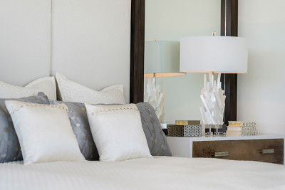 Custom luxury headboard and night stand in master bedroom