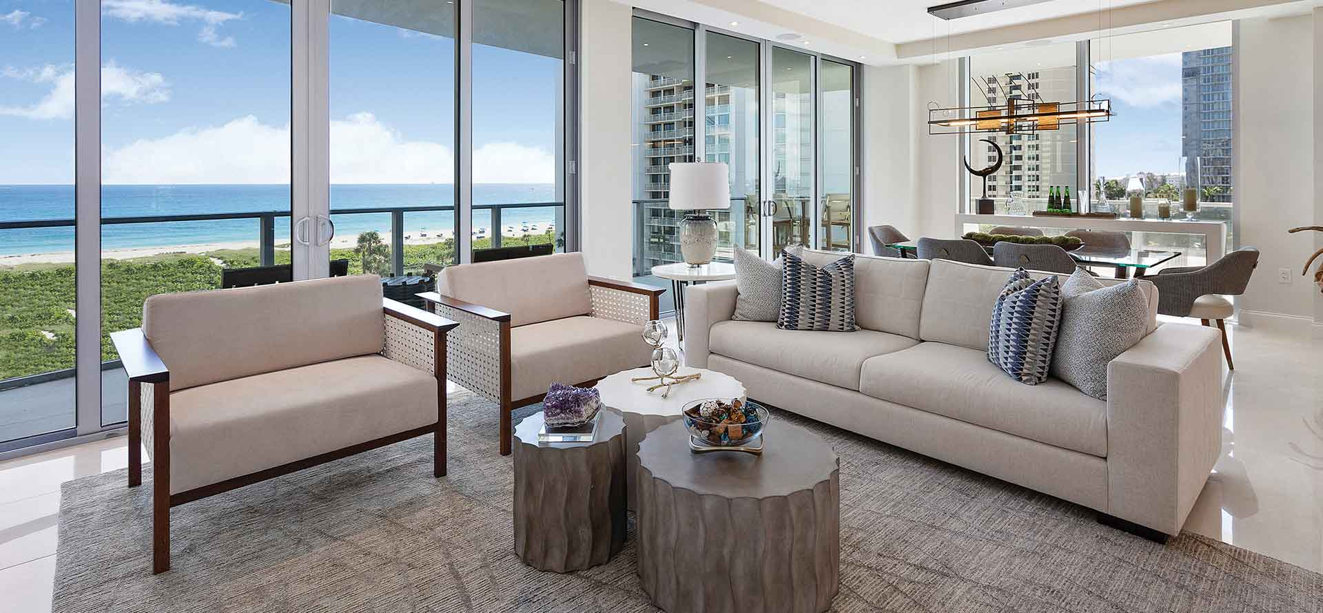 Open concept living space with luxury finishes and expansive hurricane windows